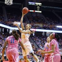 Photo - Tennessee center Isabelle Harrison (20) shoots over Kentucky forward DeNesha Stallworth (11) as forward/center Azia Bishop (50) and guard Bria Goss (13) look on in the first half of an NCAA college basketball game on Sunday, Feb. 16, 2014, in Knoxville, Tenn. (AP Photo/Wade Payne)
