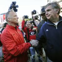 Photo -   Georgia head coach Mark Richt, left, and Georgia Tech head coach Paul Johnson meet on the field after an NCAA college football game, Saturday, Nov. 24, 2012, in Athens, Ga. Georgia won 42-10. (AP Photo/John Amis)