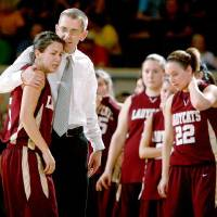 Photo -  Cashion coach Chad Tichenor consoles Alycia Cavazos during the Class A girls basketball state tournament semifinal game between Preston and Cashion  at the State Fair Arena in Oklahoma City, Friday, March 6, 2009. PHOTO BY BRYAN TERRY, THE OKLAHOMAN