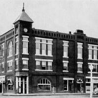 Photo - UNION BANK OF CHANDLER, BUILDING EXTERIOR: A three-story building erected in 1896 to house the bank, with the local Masonic Lodge on its top two floors, was razed in 1976 to make room for a new bank building. The bank expanded that building in the early 1980s.