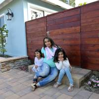 Photo -  Aniqa Jaswal poses with her daughters, Arissa, right, and Jayda on the front stoop of their home April 16 in La Jolla, Calif. Aniqa Jaswal and her husband in February bought the four-bedroom house that's about 10 minutes from the beach. Once her husband's management consulting business began flourishing, the couple felt comfortable enough after years of renting to buy their first home. AP Photo   Lenny Ignelzi -  AP