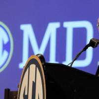 Photo - Southeastern Conference (SEC) Commissioner Mike Slive speaks during SEC media days on Monday, July 14, 2014, in Hoover, Ala. (AP Photo/Butch Dill)