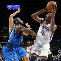 Photo - Oklahoma City's Kevin Durant (35) tries to shoot over DeShawn Stevenson (92) of Dallas during the NBA basketball game between the Dallas Mavericks and the Oklahoma City Thunder at the Oklahoma City Arena in Oklahoma City, Monday, Dec. 27, 2010. Photo by Nate Billings, The Oklahoman