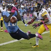 Photo -   Tennessee Titans wide receiver Kendall Wright (13) can't make a catch as Pittsburgh Steelers cornerback Keenan Lewis (23) defends during the first half of an NFL football game Thursday, Oct. 11, 2012, in Nashville, Tenn. (AP Photo/Joe Howell)
