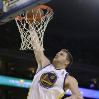 Photo - Golden State Warriors forward David Lee dunks against the New Orleans Hornets during the second quarter of an NBA basketball game in Oakland, Calif., Wednesday, April 3, 2013. (AP Photo/Jeff Chiu)