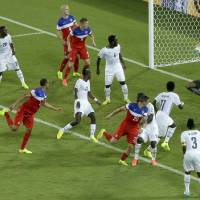 Photo - United States' John Brooks, second from left, scores his side's second goal during the group G World Cup soccer match between Ghana and the United States at the Arena das Dunas in Natal, Brazil, Monday, June 16, 2014. The United States defeated Ghana 2-1.(AP Photo/Hassan Ammar)