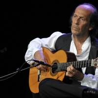 Photo - FILE - In this July 8, 2010 file photo, Spanish flamenco guitarist Paco de Lucia performs on the Miles Davis Hall stage at the 44th Montreux Jazz Festival, in Montreux, Switzerland. Spanish officials said Wednesday Feb. 26, 2014 that world-renowned flamenco guitarist Paco de Lucia has died. He was 66. Jose Ignacio Landaluce, mayor of de Lucia's native Spanish town of Algeciras said in a statement Wednesday the guitarist died in Mexico, where he lived.The cause of death was not immediately made known. De Lucia, whose real name was Francisco Sanchez Gomez, was recognized as one of the world's leading guitarists, dazzling audiences with his lightning-speed flamenco rhythms and finger work. (AP Photo/Keystone, Martial Trezzini, File)