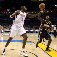 Photo - Oklahoma City's Nazr Mohammed (8) goes for the ball beside Indiana's Lance Stephenson (6) during the NBA basketball game between the Oklahoma City Thunder and the Indiana Pacers at the Oklahoma City Arena, Wednesday, March 2, 2011. Photo by Bryan Terry, The Oklahoman