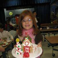 Photo - Chisholm Elementary third-grader Ali Boone proudly displays her freshly built gingerbread house. - PHOTO BY LILLIE-BETH BRINKMAN, THE OKLAHOMAN    ORG XMIT: 0812191611289946 ORG XMIT: RDA9VFV