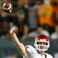 Photo - OU quarterback Landry Jones passes the ball during the college football game between the University of Oklahoma (OU) Sooners and the University of Miami (UM) Hurricanes at Land Shark Stadium in Miami Gardens, Florida, Saturday, October 3, 2009. Photo by Bryan Terry, The Oklahoman ORG XMIT: KOD