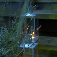 "Photo -  Arranging lanterns up a flight of steps or along a path is a lovely way to add light to a dark spot, and is especially nice for garden parties, says author and stylist Selina Lake. PHOTO PROVIDED BY ""OUTDOOR LIVING"" (RYLAND, PETERS AND SMALL)"