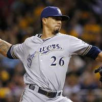 Photo - Milwaukee Brewers starting pitcher Kyle Lohse winds up during the fourth inning of a baseball game against the Pittsburgh Pirates in Pittsburgh on Friday, April 18, 2014. (AP Photo/Gene J. Puskar)