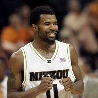 Photo - BIG 12 TOURNAMENT / COLLEGE BASKETBALL / REACTION / CELEBRATE / CELEBRATION: Missouri's Zaire Taylor (11) celebrates beating Missouri 76-70 in an NCAA college basketball game at the Big 12 Conference men's tournament in Oklahoma City, Friday, March 13, 2009.  Taylor was the high point scorer in the game with 19 points. (AP Photo/Sue Ogrocki) ORG XMIT: OKRH131