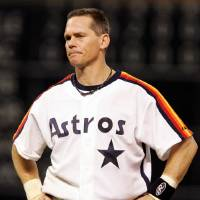Photo - FILE - This Sept. 28, 2007 file photo shows Houston Astros' Craig Biggio grimacing during a baseball game against the Atlanta Braves in Houston. Steroid-tainted stars Barry Bonds, Roger Clemens and Sammy Sosa have been denied entry to baseball's Hall of Fame with voters failing to elect any candidates for only the second time in four decades. Biggio, 20th on the career list with 3,060 hits, topped the 37 candidates with 68.2 percent of the 569 ballots, 39 shy of the 75 percent needed. (AP Photo/Pat Sullivan, File)
