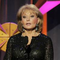 "Photo - FILE - This June 23, 2012 file photo shows Barbara Walters presenting an award onstage at the 39th Annual Daytime Emmy Awards in Beverly Hills, Calif. Walters has the chickenpox and remains hospitalized more than a week after going in after falling and hitting her head at a pre-inaugural party in Washington on Jan. 19. A fellow host on the ""The View,"" Whoopi Goldberg, said Monday, Jan. 28, that Walters has been transferred to a New York hospital and hopes to go home soon. (Photo by Chris Pizzello/Invision/AP, file)"