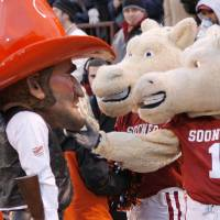 Photo - BEDLAM: OU mascots Boomer and Sooner, right, joke with OSU mascot Pistol Pete during the second half of the college football game between the University of Oklahoma Sooners (OU) and the Oklahoma State University Cowboys (OSU) at the Gaylord Family -- Oklahoma Memorial Stadium on Saturday, Nov. 24, 2007, in Norman, Okla.   Photo By NATE BILLINGS, The Oklahoman ORG XMIT: KOD