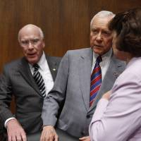 Photo - Senate Judiciary Committee members, from left, chairman Sen. Patrick Leahy, D-Vt., Sen. Orrin Hatch, R-Utah, and Sen. Dianne Feinstein, D-Calif., confer on Capitol Hill in Washington, Thursday, June 25, 2009, before the committee's hearing on hate crime legislation. (AP Photo/Harry Hamburg) ORG XMIT: DCHH117