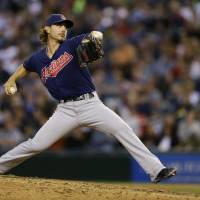 Photo - Cleveland Indians starting pitcher Josh Tomlin throws in the eighth inning of a baseball game against the Seattle Mariners, Saturday, June 28, 2014, in Seattle. (AP Photo/Ted S. Warren)