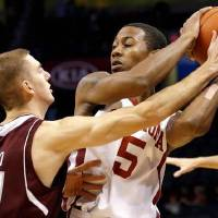 Photo -  Oklahoma's Je'lon Hornbeak looks to pass the ball as A&M's Alex Caruso defends during the All-College Classic between the University of Oklahoma and Texas A&M at the Chesapeake Energy Arena in Oklahoma City, Saturday,Dec. 15, 2012. Photo by Sarah Phipps, The Oklahoman