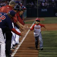 Photo - Plaza Towers Elementary student Dacarri Davis runs the bases during a Home run for life ceremony at the Oklahoma City Redhawks game agains the New Orleans Zephyrs at the Chickasaw Bricktown Ball Park. Friday, April 11, 2014. Photo by Sarah Phipps, The Oklahoman