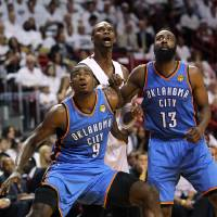 Photo - Miami Heat's Chris Bosh, center, fights for position under the basket against Oklahoma City Thunder's Serge Ibaka (9) and James Harden (13) during the third quarter of Game 3 in the NBA Finals basketball series, Sunday, June 17, 2012, in Miami. The Heat won 91-85. (AP Photo/El Nuevo Herald, David Santiago)  MAGS OUT ORG XMIT: FLMEH308