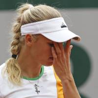 Photo - Denmark's Caroline Wozniacki wipes her face during the first round match of the French Open tennis tournament against Belgium's Yanina Wickmayer at the Roland Garros stadium, in Paris, France, Tuesday, May 27, 2014. (AP Photo/Darko Vojinovic)