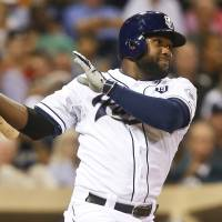 Photo - San Diego Padres' Abraham Almonte drills a line drive to center field, scoring Tyson Ross from second in the third inning of a baseball game Tuesday, Aug. 26, 2014, in San Diego.  (AP Photo/Lenny Ignelzi)