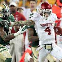 Photo - Oklahoma's Kenny Stills (4) catches long pass and is run out of bounds by Baylor's Ahmad Dixon (6) during the college football game between the University of Oklahoma Sooners (OU) and the Baylor Bears (BU) at Floyd Casey Stadium on Saturday, Nov. 19, 2011, in Waco, Texas. Photo by Steve Sisney, The Oklahoman