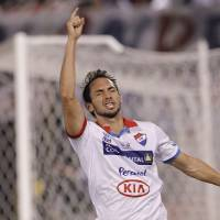 Photo - Julio Santa Cruz of Paraguay's Nacional celebrates after scoring against Argentina's San Lorenzo during the first leg of the Copa Libertadores soccer final in Asuncion, Paraguay, Wednesday, Aug. 6, 2014. The game ended in a 1-1 tie. (AP Photo/Cesar Olmedo)