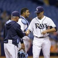 Photo - Tampa Bay Rays manager Joe Maddon, left, takes starting pitcher Matt Moore, right, out of the game against the Toronto Blue Jays during the sixth inning of a baseball game Wednesday, April 2, 2014, in St. Petersburg, Fla. Looking on is catcher Jose Molina. (AP Photo/Chris O'Meara)