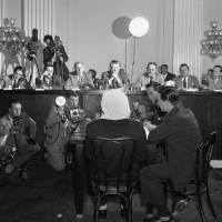 Photo -   FILE - In this Feb. 6, 1952, file photo, a masked former Polish soldier testifies to house committee on Katyn Forest massacre in Washington. With him at the witness table, Roman Pucinski, interpreter beside him, right. Committee members, left to right on rostrum: Reps. Timothy Sheehan, (R-Ill., Alvin E. O'Konski, R-Wis., George A. Dondero, R-Mich., Ray J. Madden, D-Ind., Daniel J. Flood, D-Pa., Foster Furcolo, D-Mass., and Thaddeus M. Machrowicz, D-Mich. The Obama administration is opposing a Jewish group's bid to levy civil fines against Russia for failing to obey a court order to return its historic books and documents — a dispute which has halted the loan of Russian art works for exhibit in the United States. In a recent court filing, the Justice Department argued that judicial sanctions against Russia in this case would be contrary to U.S. foreign policy interests and inconsistent with U.S. law. The Jewish group, Chabad-Lubavitch of Brooklyn, N.Y., has already persuaded Chief Judge Royce Lamberth of the U.S. District Court here that it has a valid claim to the tens of thousands of religious books and manuscripts, some up to 500 years old, which record the group's core teachings and traditions. (AP Photo/Bill Allen)
