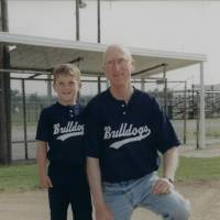 Photo - Bishop McGuinness High School baseball player Andrew Murphy, left, with his father Tom Murphy. Photo provided