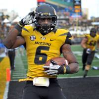 Photo -   Missouri running back Marcus Murphy celebrates after scoring on a nine-yard touchdown run during the second half of an NCAA college football game against Kentucky Saturday, Oct. 27, 2012, in Columbia, Mo. Missouri won 33-10. (AP Photo/L.G. Patterson)