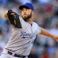 Photo - Kansas City Royals starting pitcher Danny Duffy throws to the plate against the Colorado Rockies during the first inning of a baseball game Wednesday, Aug. 20, 2014, in Denver. (AP Photo/Jack Dempsey)