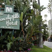 Photo - FILE - In this April 25, 2012 file photo, the entrance to the Beverly Hills Hotel is seen in Beverly Hills, Calif.  Hollywood is responding to harsh new laws in Brunei by boycotting the Beverly Hills Hotel. The Motion Picture & Television Fund joined a growing list of organizations and individuals Monday, May 5, 2014, refusing to do business with hotels owned by the Sultan or government of Brunei to protest the country's new penal code that calls for punishing adultery, abortions and same-sex relationships with flogging and stoning.  (AP Photo/Matt Sayles, File)