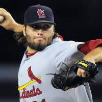 Photo -   St. Louis Cardinals starting pitcher Lance Lynn throws to the plate during the first inning of their baseball game against the Los Angeles Dodgers, Thursday, Sept. 13, 2012, in Los Angeles. (AP Photo/Mark J. Terrill)