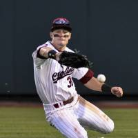 Photo -   South Carolina's Evan Marzilli fails to catch a fly ball hit for a double by Arkansas' Tim Carver in the third inning of an NCAA College World Series baseball elimination game in Omaha, Neb., Friday, June 22, 2012. The winner advances to play Arizona in the championship series. (AP Photo/Ted Kirk)