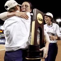 Photo - COLLEGE SOFTBALL / ALYSON MCWHERTER / TROPHY / CELEBRATE / CELEBRATION: University of Washington's Danielle Lawrie, center, hugs Aly McWherter in front of Amanda Fleischman after their win over Florida in the second softball game of the championship series between Washington and Florida in Women's College World Series at ASA Hall of Fame Stadium in Oklahoma City, Tuesday, June 2, 2009. Photo by Bryan Terry, The Oklahoman ORG XMIT: KOD