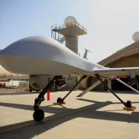 Photo - FILE - This June 21, 2007 file photo show a MQ-4 Predator controlled by the 46th Expeditionary Reconnaissance Squadron stands on the tarmac at Balad Air Base, north of Baghdad, Iraq.  A Pentagon official says the U.S. has started flying armed drones over Baghdad to protect U.S. civilians and military forces in the Iraqi capital. The official said the flights started in the last 24 to 48 hours to bolster manned and unmanned reconnaissance flights the military has been sending over violence-wracked Iraq in recent weeks. He spoke on condition of anonymity because he was not authorized to discuss the new flights on the record. (AP Photo/Maya Alleruzzo, File)
