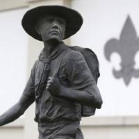 Photo - A statue of a Boy Scout stands in front of the National Scouting Museum, Monday, Jan. 28, 2013, in Irving, Texas. The Boy Scouts of America announced it is considering a dramatic retreat from its controversial policy of excluding gays as leaders and youth members. (AP Photo/LM Otero)