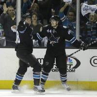 Photo - San Jose Sharks' Marc-Edouard Vlasic (44) celebrates with Joe Pavelski, left, after Vlasic scored against the Los Angeles Kings during the second period of Game 1 of an NHL hockey first-round playoff series Thursday, April 17, 2014, in San Jose, Calif. (AP Photo/Ben Margot)