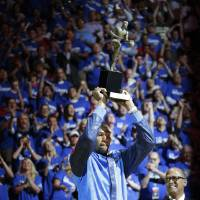 Photo - Kevin Durant holds up the Kia MVP trophy before Game 2 of the Western Conference semifinals in the NBA playoffs between the Oklahoma City Thunder and the Los Angeles Clippers at Chesapeake Energy Arena in Oklahoma City, Wednesday, May 7, 2014. Photo by Bryan Terry, The Oklahoman
