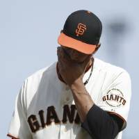 Photo - San Francisco Giants pitcher Javier Lopez walks off the mound during the eighth inning of a baseball game against the Colorado Rockies in San Francisco, Sunday, June 15, 2014. The Rockies won 8-7. (AP Photo/Jeff Chiu)