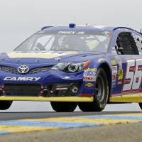 Photo - Martin Truex Jr. races in the NASCAR Sprint Cup series auto race, Sunday, June 23, 2013, in Sonoma, Calif. (AP Photo/Eric Risberg)