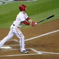 Photo -   Washington Nationals' Bryce Harper watches his solo home run in the third inning of Game 5 of the National League division baseball series against the St. Louis Cardinals on Friday, Oct. 12, 2012, in Washington. (AP Photo/Nick Wass)