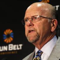 Photo - Sun Belt Commissioner Karl Benson talks during the Sun Belt media day in New Orleans, Tuesday, July 22, 2014. (AP Photo)