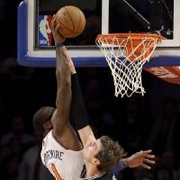 Photo - New York Knicks forward Amare Stoudemire (1) tips the ball in over the defense of San Antonio Spurs forward Tiago Splitter (22) in the first half of their NBA basketball game at Madison Square Garden in New York, Thursday, Jan. 3, 2013. (AP Photo/Kathy Willens)