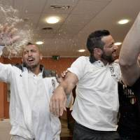 Photo - Juventus' Arturo Vidal, left, and Fabio Quagliarella celebrate after winning the Serie A overall soccer title, in a Turin hotel, Italy, Sunday, May 4, 2014. Juventus clinched its third straight and 30th overall Serie A title Sunday without even playing. With second-place Roma losing 4-1 at Catania, Juventus' eight-point lead became insurmountable because Roma only has two matches remaining. Juventus, which has three games to play, can celebrate when it hosts Atalanta on Monday although the Turin squad's players and coach Antonio Conte were already celebrating outside their team hotel wearing championship T-shirts. (AP Photo/Daniele Badolato, Lapresse)