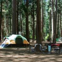 Photo - This undated image provided by the National Park Service shows tents pitched at a campground at Yosemite National Park in California. The thought of camping out can be daunting, but packing a few strategically chosen items like an inflatable mattress and food that's easy to grill can reduce the ick factor. (AP Photo/National Park Service)