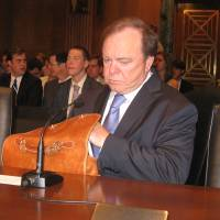 Photo - Continental Resources CEO Harold Hamm prepares to testify before a U.S. Senate committee Tuesday about federal tax policy related to energy.  Chris Casteel - The Oklahoman